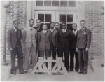 Black and white photograph printed on matte paper of Lloyd L. Gaines (second on left) with Alpha Phi Alpha fraternity brothers.